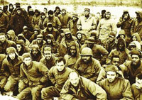 Photo:This historical picture shows American prisoners captured by the China Volunteer Army had a group picture taken as a souvenir in 1951.