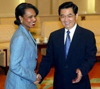 Photo:Chinese President Hu Jintao meets U.S. National Security Adviser Condoleezza Rice (L) in Beijing's Great Hall of the People July 9, 2004.