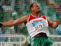 Photo:Robert Fazekas of Hungary claims the men's discus gold medal with a 70.93 meters throw at the Olympic Games August 23, 2004.