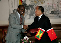 Photo:Chinese Foreign Minister Li Zhaoxing (R) shakes hands with his Grenadian counterpart Elvin Nimrod after signing a joint communique to resume diplomatic ties between the two countries, in Beijing, capital of China, Jan. 20, 2005.