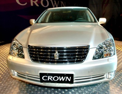 Images Toyota Logo on The 12th Generation Toyota Crown Sedan Car Drives Off Production Line