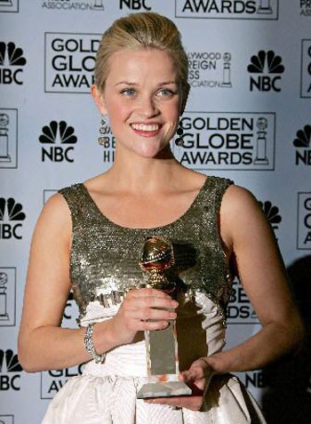 Hollywood actress Reese Witherspoon holds her award for Best Performance by