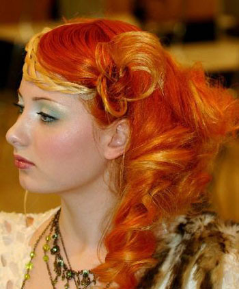 A model displays a fashion hairstyle creation during the annual hairstyle