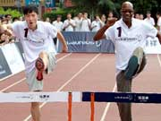 Liu Xiang teaches hurdling skills to middle school students