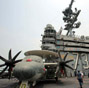 US aircraft carrier docks in HK, welcomes PLA aboard