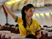 Stewardesses in Brazilian soccer jerseys