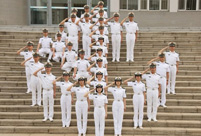PLA naval cadets toss their hats at graduation ceremony