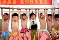 Children attend gymnastics training in summer