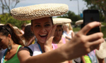 Contestants for Miss Bikini World experience Chinese traditional culture