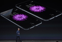 Apple introduces larger iPhones, new watch