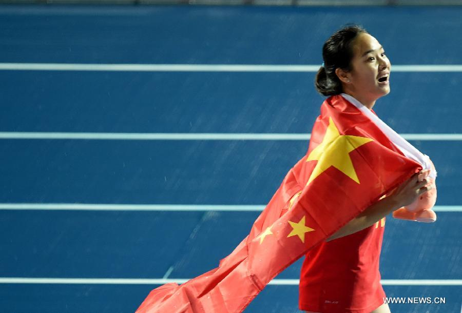 Wei Yongli of China celebrates after the women's 100m final of athletics at the 17th Asian Games in Incheon, South Korea, Sept. 28, 2014. Wei Yongli won the gold medal with 11.48 seconds. (Xinhua/Huang Zongzhi)
