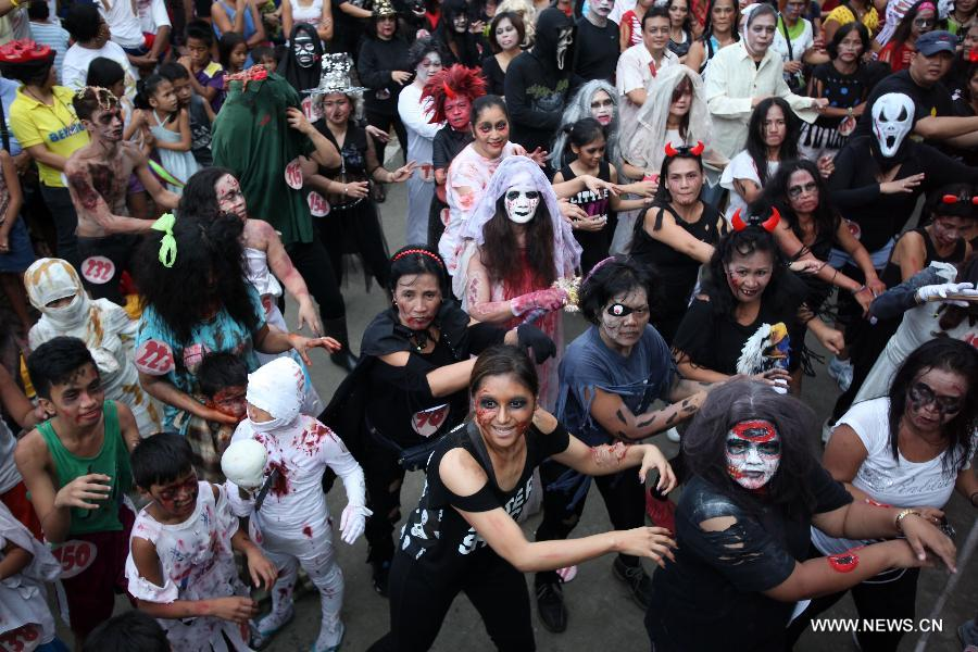People wearing zombie make-up and costumes dance along with other participants during a Zombie Zumba Party in Mandaluyong City the Philippines Oct. 26 ...  sc 1 st  Peopleu0027s Daily Online & Zombie Zumba Party held to celebrate Halloween in Philippines (4 ...