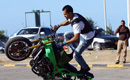 Libyan young men show motorcycle riding skills