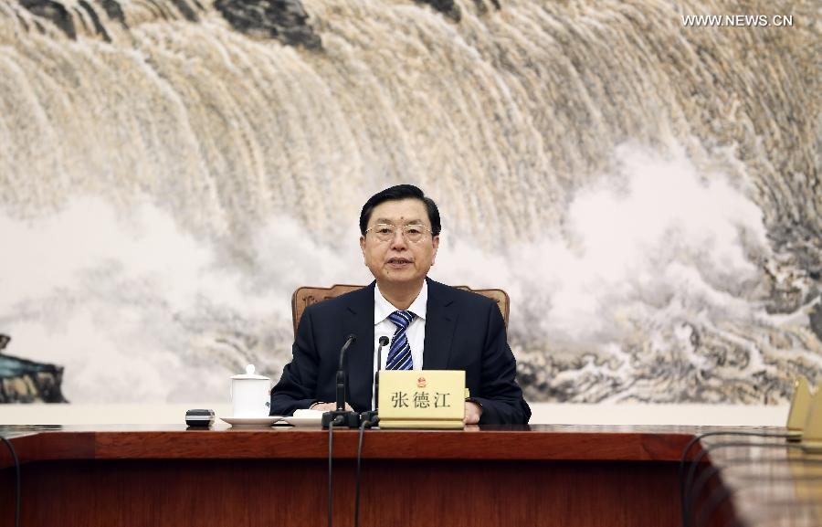 Zhang Dejiang, chairman of the Standing Committee of China's National People's Congress (NPC), presides over the 38th meeting of the NPC Standing Committee's chairman and vice chairpersons, at the Great Hall of the People in Beijing, capital of China, Dec. 26, 2014. (Xinhua/Ding Lin)