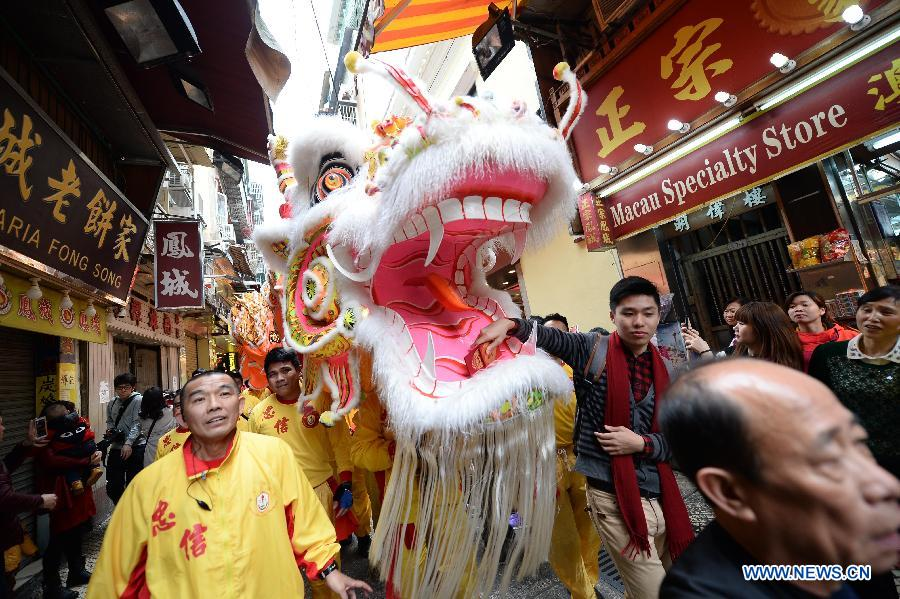 People perform dragon dance to celebrate the Year of Sheep in Macao, south China, on Feb. 19, 2015, the first day of Chinese lunar new year. (Xinhua/Cheong Kam Ka)