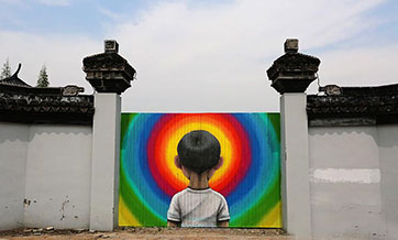 French street artist beautifies cottages in Shanghai