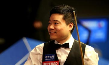 China's Ding beats Higgins to reach quarterfinals at snooker worlds