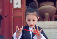 Cute young Taoist priest in Beijing