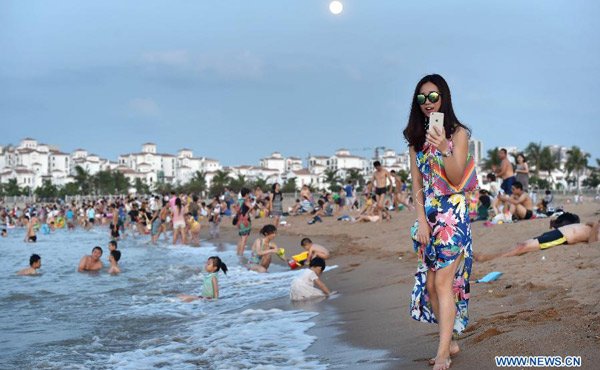Top 10 most competitive chinese cities in belt and road initiative citizens play along the beach of haidian island in haikou capital city of south chinas hainan province july 1 2015photoxinhua publicscrutiny Gallery