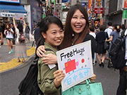 Chinese and Japanese Youth Embrace in Tokyo