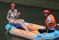 Bikini beauties lifeguards in river rafting place