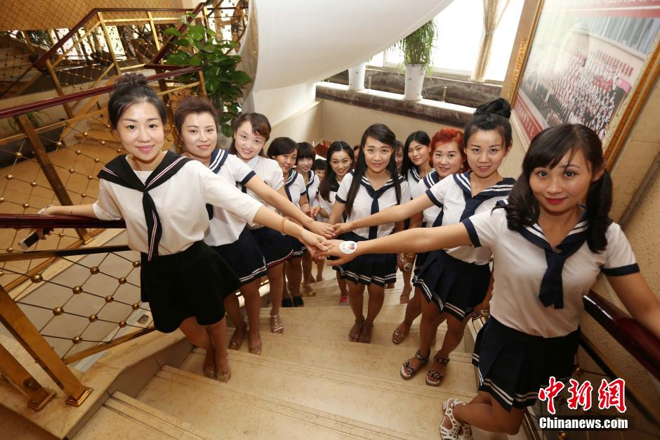 Young mums hold school uniform party in E China
