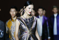 Fashion show staged in Forbidden City at night