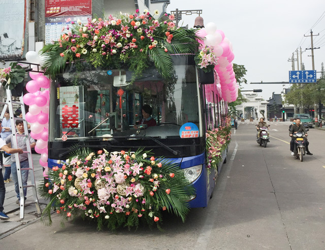 Transforming bus into wedding car, a low carbon consumption pattern