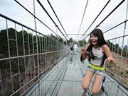 First Glass Suspension Bridge in China Opens to Visitors