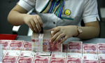 US softens criticism of yuan valuation