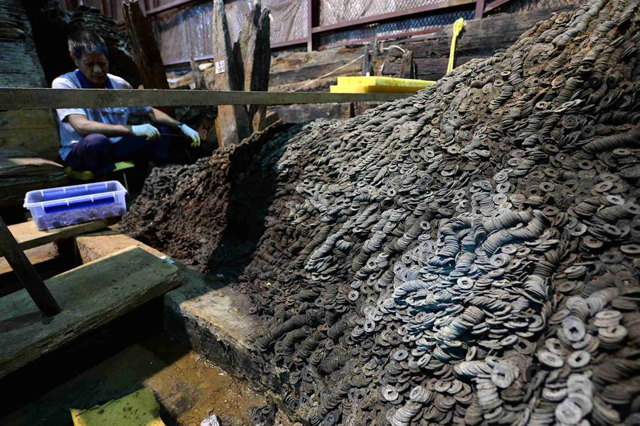 10 tons of copper coins unearthed in 2,000 years old ancient tomb