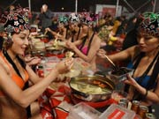 Bikini models attend hot pot banquet in Hefei