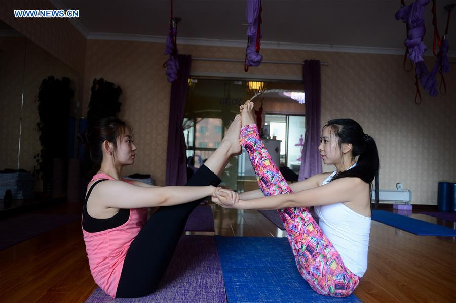 Young girls enjoy Yoga in China's Qinghai