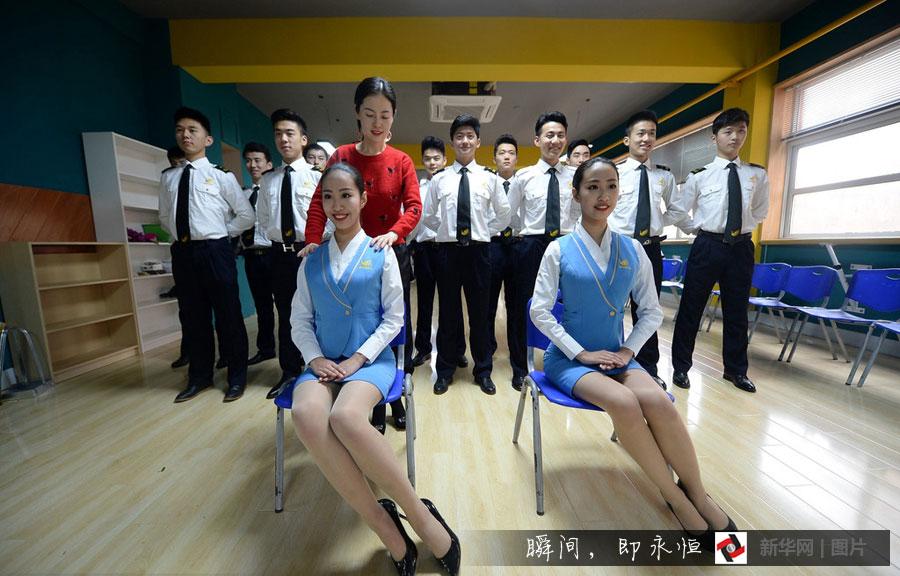 Twin sisters take part in flight attendant training program ...