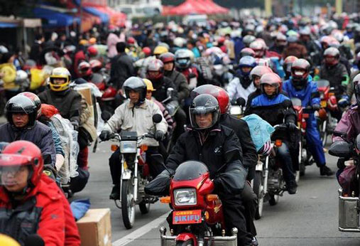 First freight train takes motorcycles home for Spring Festival