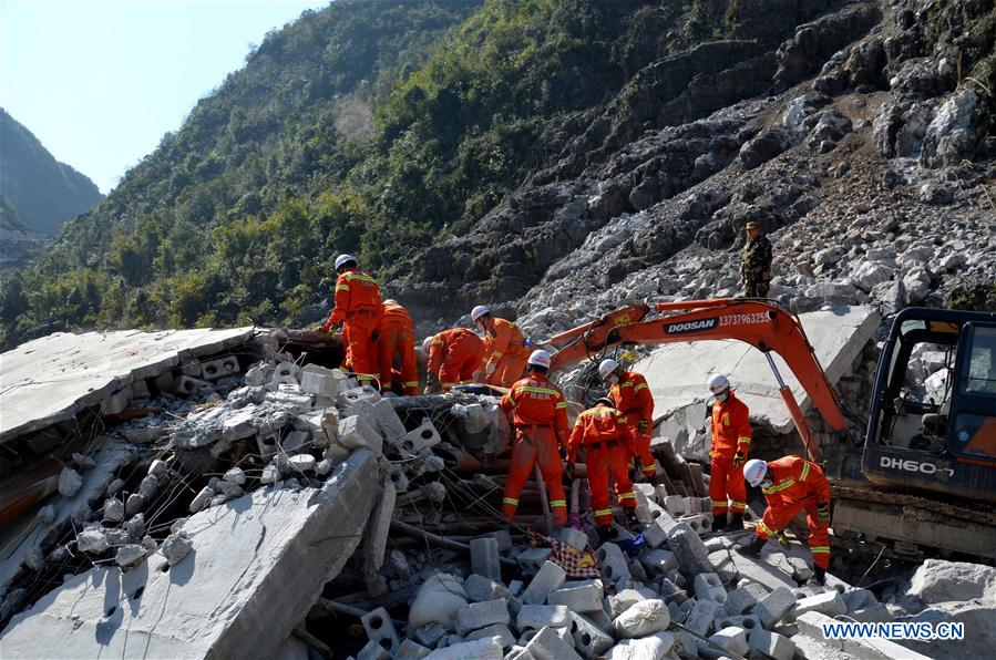 Rescuers work at the site of a landslide at Fude village in Du'an Yao Autonomous County of Hechi City, south China's Guangxi Zhuang Autonomous Region, Feb. 8, 2016. Six people were killed after a landslide destroyed a two-story building in Du'an early Monday morning. According to local sources, it didn't rain when the accident happened. The cause is being investigated. Officials of the Hechi city have ordered a thorough inspection for hidden safety hazard. (Xinhua)