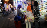 Chinese surrogate buyers go on shopping sprees in Japan