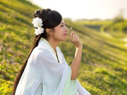 Female official wearing traditional Han costume to promote local tourism