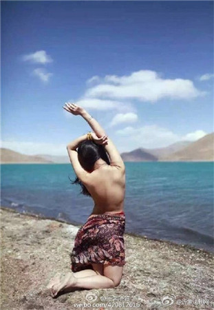 Chinese woman poses nude at sacred Tibetan lake