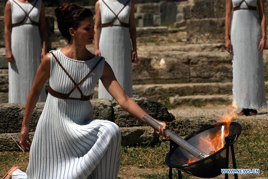 flame lighting olympics. olympic flame for 2016 rio summer olympics lit in birthplace of games - people\u0027s daily online lighting o