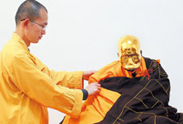 Monk's mummified body to be made into a gold Buddha statue