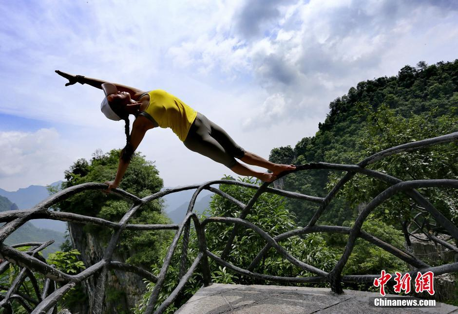 Yoga performance on cliff road in C China