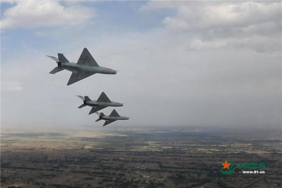 Fighters conduct drill over the Qilian Mountains