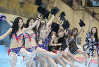 Students take stylish bikini graduations photos