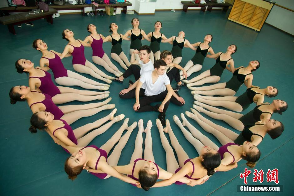 Dancing students pose for graduation photos