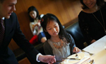Wealthy Chinese children take class to learn Western table manners