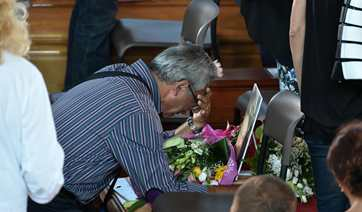 Relatives mourn for earthquake victims in Italy