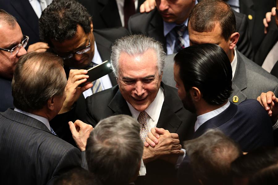 Profile brazils new president michel temer peoples daily online 31 2016 xinhua michel temer c receives greetings following his swear in ceremony as president of brazil in brasilia brazil aug 31 2016 m4hsunfo