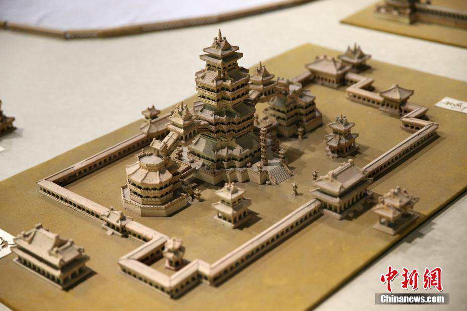 Elderly man carves miniature landscape of Daming Palace with bricks