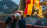 Beijing temple offers free Laba porridge to devotees and tourists alike